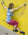 Working a backstep on the bouldering wall.