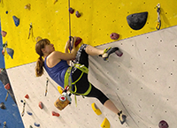 Using a high toehook to take a rest on a problem.