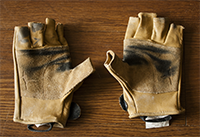 Leather belay gloves with dirty palms.