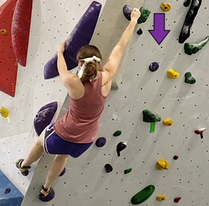 Grabbing and pulling down on a purple hold