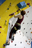 Climbing an overhung route at Climb UP.