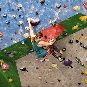 Going for a kneebar to stablize on a overhanging purple problem.